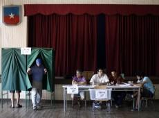 Políticos chilenos esperam abstenção alta e pedem volta de voto obrigatório