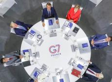 Vídeo flagra Merkel discutindo com Macron o que fazer com Bolsonaro